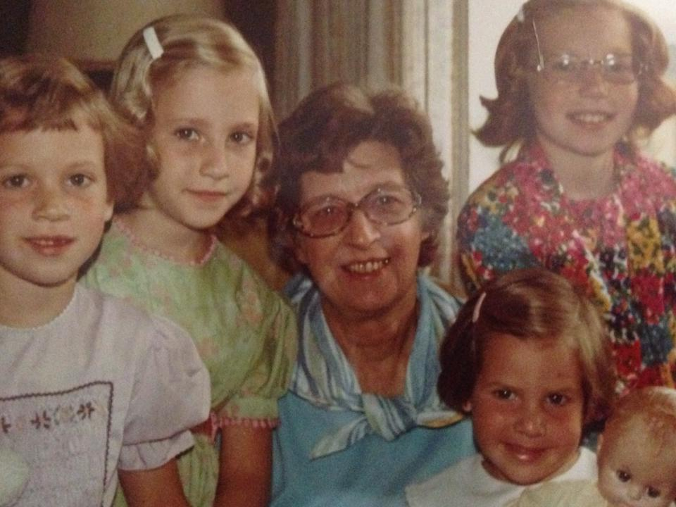 My three sisters and I, a few years ago, with our grandmother. I'm the one in green who is refusing to smile.